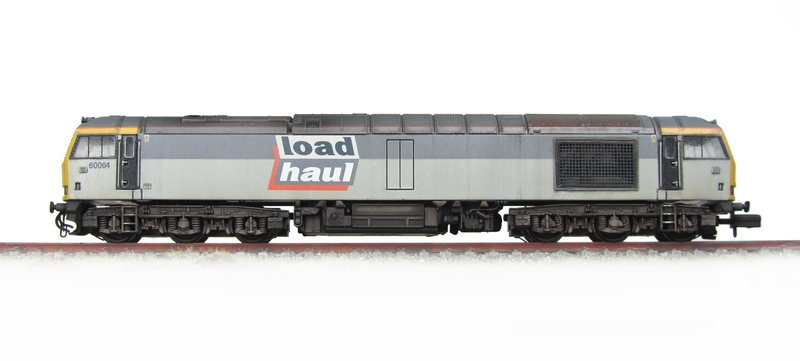 60064 with change of livery to Loadhaul and upper grey band resprayed to lighter version.